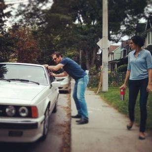 """Anita looks on as Vince (""""Oliver"""") rehearses a scene with Shannon (""""Samantha""""), in the car."""