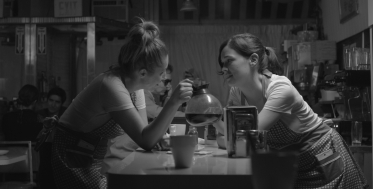 A still from the film: Sam and Jenny chit-chat during a graveyard shift.